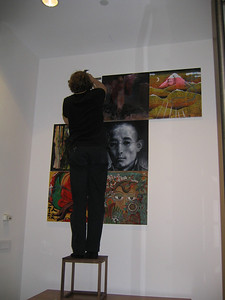 Luc Schaedler hangs the painting installation from the Gendun Chopel Artists' Guild, Lhasa.