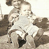 1940 - Marge holding new brother, Dwaine