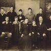 189x - front: Alfred, Louise, mother Emily, Lillian, father Henry; back: Charles, George, Charity, Sherman, Frank, Anson