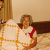 1973 - Oct - Mary Vollenweider and Catherine Voas admiring quilt from Aunt Eda