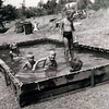 1954 - Bettey, Bill, Tom and Bob Hirsch kids in pool at Fresno. Standing - neighbor Billy Johnson. Pool made from tarp that covered trailor on move from Omaha to Fresno.