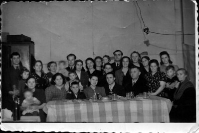 """Holocaust Survivors - ""Wie ahin soll ich gehen?""  Living together in a displaced persons camp after WW II On left: Wolf Lopata, Barbara, Leah, Loretta (baby in Leah's lap) Next to Wolf (""Velvul"") is Ida (Chaya) Altman, mother of Frieda (to her right) and Leah. Frieda holds Irving; Mendel is to the right and Fred in front of him."