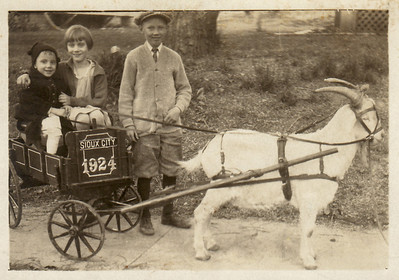 1923 Eloise, Marianna and Morris Miller with their pet goat. Sioux City, IA.