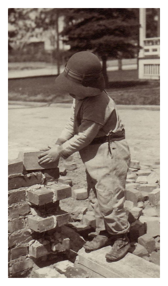 1917  Morris Miller helping to prepare wall at his Aunt Martha's home, 3734 Jackson Blvd. in Sioux City, IA.