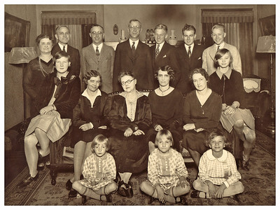 "1926 Back row, left to right:  Martha (Ewald) Whitmer, Ray Miller, Leslie Whitmer (husband to Martha), George Whitmer, Walt Ewald, Orville Ewald, Morrie Miller.  Seated, left to right: Marie Ewald, Emma Miller (Geggy), Mary Whitmer (""Our Mom""), Myrtle Whitmer, Bess Whitmer (wife to George), Marianne Miller.  On floor, left to right: Mary Lou Whitmer, Jaynie Whitmer, Eloise Miller."