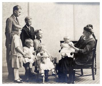 1923 April Grandmother Whitmer with her grandchildren:  Boys from left to right: Orville Ewald , Walt Ewald (Leslie's nephews by marriage to Martha Ewald), and Morris Miller.  Girls from left to right: Marianne and Eloise Miller, Mary Lou and Jaynie Whitmer (children of George and Bess Whitmer).