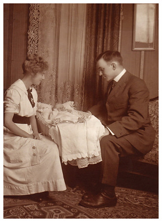 1913 October 1 Morris Miller was the first born of three children in Sioux City, Iowa on September 6, 1913. His parents Emma Whitmer and Ray Miller admire Morris in his bassinet.