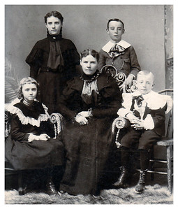 1895 Clockwise surrounding Mary Whitmer (Age 27) are her four children: Emma (Geggy, Age 7), Myrtle (Age 12), Leslie (Age 10), George (Age 4).