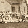 """1920-08-16 - 50th Wedding Anniversary of William C and Mary Elizabeth Barger; Swea city, IA. <br /> Note: All surnames are Barger unless noted. <br /> Standing: Ernest, Ethel, Elsie, Grace Shirley, John C, Clara Belle Barger, George Moore, Emma Moore, Henry Crossley, Mary Ellen Crossley, William H, Margaret, Amanda Jane McCrary, Lucinda May Farrington, Arthur Farrington, Theron Wm., Marion Raymond McCrary, Gerald R Imbody, William Shirley.<br /> On Chains: Samuel, John M, Sarah E, Melissa A Hall, William C, Mary E, Catharine A Anderson, Rev. Charles W Anderson, Abraham, Hannah Crossley.<br /> Seated on lawn: John Shirley, Ethel Moore, LeRoy Crossley, Mable Crossley, Doris Farrington, Olive Crossley, Glenn Crossley, William Moore, Pearl Shirley, Alava Farrington, Gladys Crossley, May Moore, Opal McCrary, Minnie, Evelyn, Marjorie, Chester Farrington, Walter McCrary, Donald, Evelyn Moore.<br /> Names obtained from """"The Cobb-Barger Family"""" compiled by Shirley K Smith, 1990."""