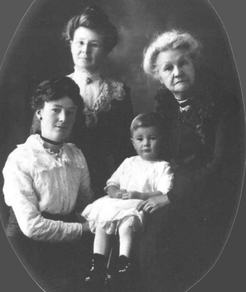 Four Generations<br /> Top Right: Mrs. Francis Ellen (Young) Dunton<br /> Top left: Cora Estelle (Dunton) Bennett<br /> Bottom Left: Nellie Ethel (Bennett) Towle<br /> Child: Robert Vernon Towle (aka Russell Towle)