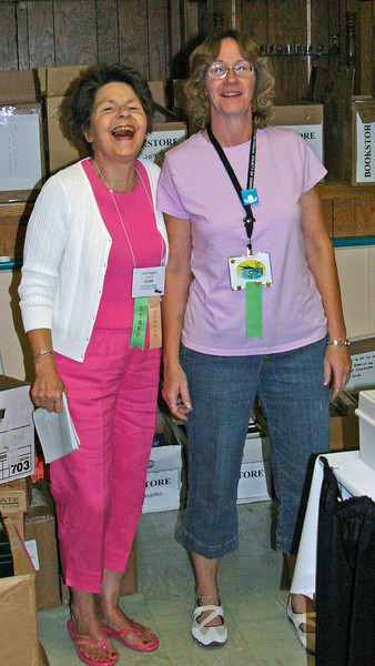 Gail Gingrich (left) and a partner in crime take a breather from chores in the AHSGR Bookstore.
