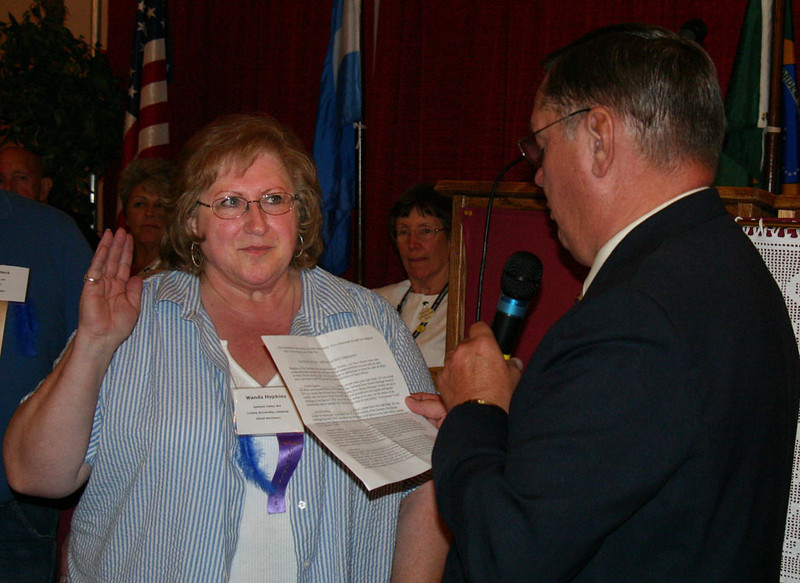 Wanda Hopkins of Spokane is sworn in as GRHS Secretary by Al Feist of Hebron, North Dakota.