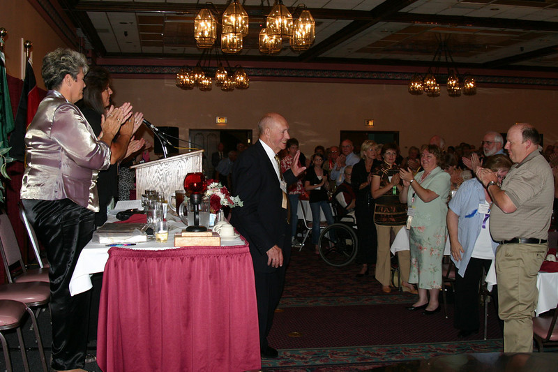 Mayo Flegel of Mankato, Minnesota, waves at well wishers after he was presented with one of two AHSGR Distinguished Service Awards presented for 2008.
