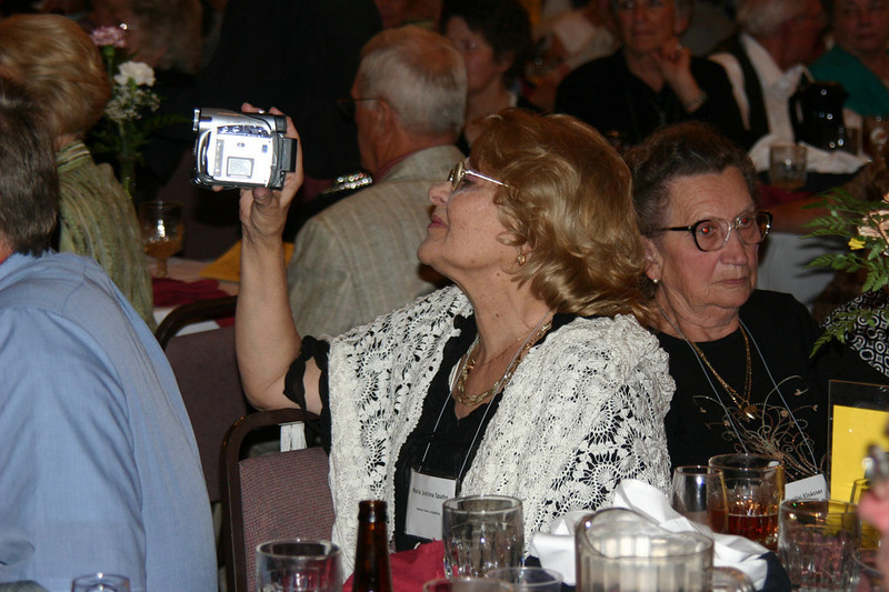 Maria Justina Spahn of Buenos Aires, Argentina focuses her video camera on one of the many banquet presentations to be shared with others in Argentina.