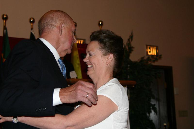 Mayo Flegel gives a congratulatory hug to Marianne Long from Oklahoma City, Oklahoma.