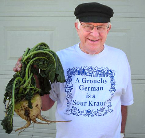 "It ain't sourkraut friends! When Jack Preston gave his Saturday workshop <i> Germans from Russia and North Platte Valley Agriculture,</i> he brought a ""show and tell"" sugar beet.  That's Ken Koehler of Arvada, Colorado holding the specimen. Thanks, Ken, for sharing this photograph!"