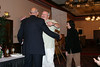 Mayo Flegel congratulates Don Soeken of Laurel, Maryland.  Don's wife, Karen, chuckles.