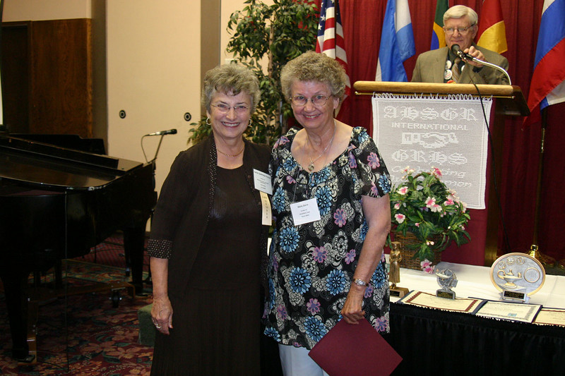 Nora Dorn (right) of Arvada, Colorado, receives an award on behalf of one of the Storytelling winners.