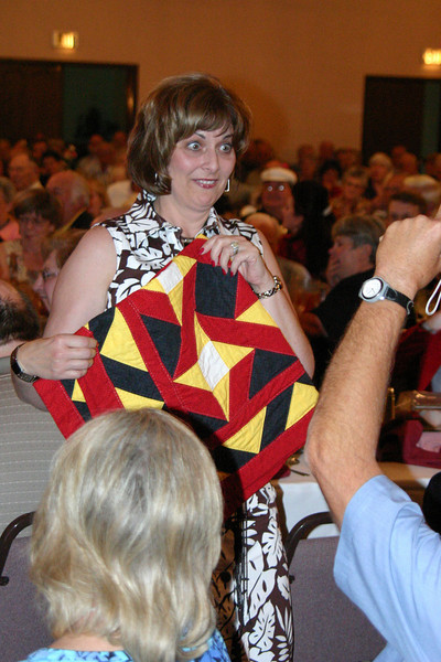 Debbie Kilwien was more than a bit surprised at winning one of the raffle prizes.  She had donated a beautiful item herself -- a U.S. flag afghan.