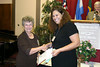 Erin Deis (right) of Los Angeles, receives her Storytelling Award from Karen Suderman Penner of Newton, Kansas.