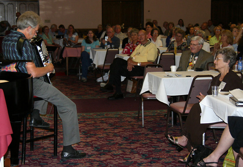 John Stehle from Denver tickles the accordian ivory in tribute to Aolph Lesser.