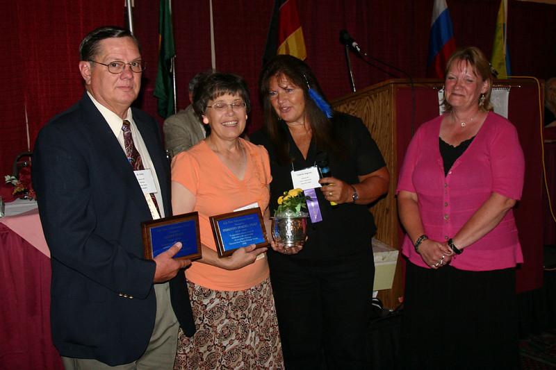 Lifetime Achievement Awards were presented to Al and Dorothy Feist (left) of Hebron, North Dakota by GRHS President Val Ingram.  Rachel Schmidt is at right.