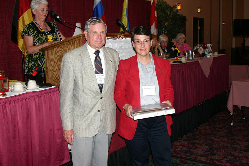 Catherine Pfau Stewart of Aurora, Colorado, accepted an AHSGR Distinguished Service Award on behalf of the late Raymond Pfau.  AHSGR President Jerry Siebert presented the award.