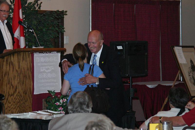 Tanja Schell and Mayo Flegel hug.