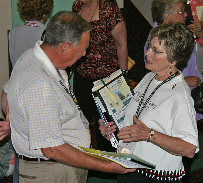 Ed Hoak from Long Grove, Illinois, visits with Corinne Koehler of Arvada, Colorado.