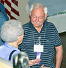 Harold Ehrman of Pacific Palisades, California, chats with another convention attendee.