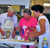 Marge Benson (center) of Sacramento and Valentyna Kramer (right) from Rapid City, South Dakota put together the strawberry Katfilta on Friday under the watchful eye of Ken Koehler of Arvada, Colorado.  We understand the finished product was terrific! It was one of three Cultural Cooking Classes offered.