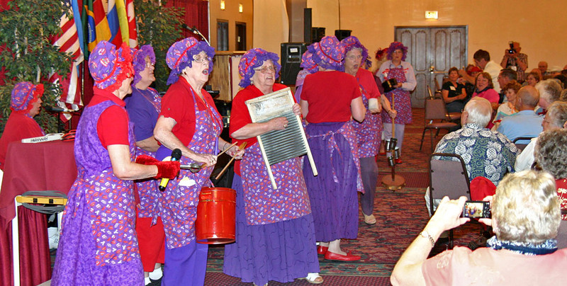 There's not much we can say about the Crimson Dames, the Red Hat Society Kitchen Band led by Bev Miller.  And whatever we might say would be inadequate!