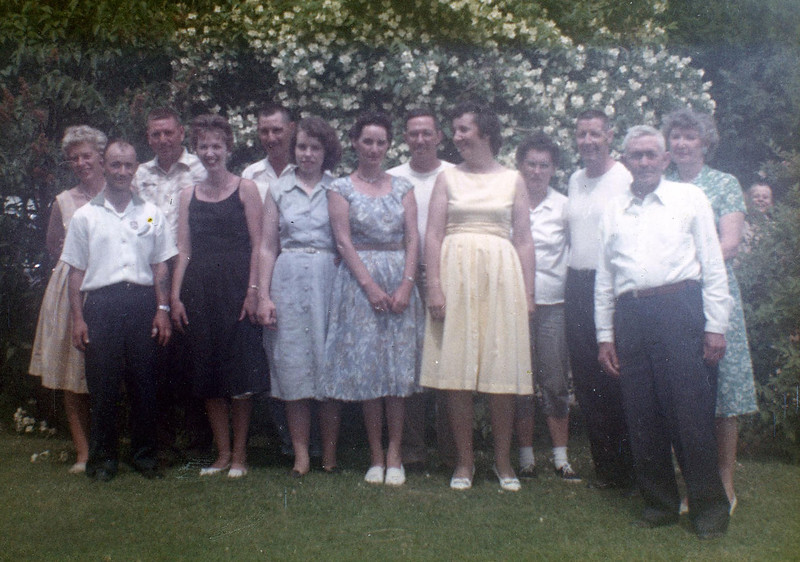 Back: Audrey & Cliff Clark, Frank Clark, Jerry & Beverly Clark, Raymond and Eva (Tom Clark in background).<br /> Front: Alvin and Doris (Clark) Grovogel, Dorothy (Foote) Clark, Amelia (Clark) Thiry, Edith (Wilke) Clark and Sanford Clark.