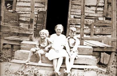 Left to Right: Erskine, Ruth Virginia, and Mason Clark circa 1920 on Parkersville Road, Westview, Virginia.    Possibly father Homer Otho Clark  (1884-1923) in window.  Homeplace later burnt soon after photo.
