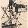 Surveying clambeds(?) or Lake Washington, c1910