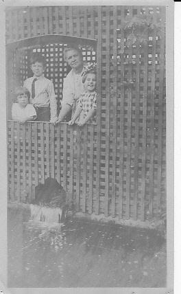 Jennie Dohm and grandchildren in springhouse, Seattle, c1910