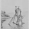 Edw C Dohm surveying clambeds(?) Washington, c1910