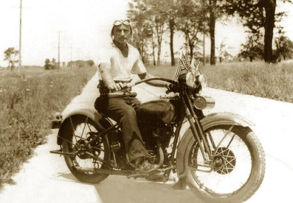 King of the Road, RAY ELLERO (1912-2004), on his 1930 Harley-Davidson Motorcycle (Dual Headlight, 2-cam V-Twin Flathead) Photograph taken on 8 Mile Road, Detroit, Michigan.  ca. 1932.
