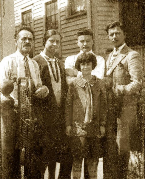 L to R: GIOVANNI ELLERO (1878-1948)  with his wife Teresa (Di Biaggio) Ellero (1877-1965), daughter Adelia [ne Lombardi] (1918-2004), sons Romano (1912-2004), and Pietro (1906-1994). Taken in front of their home in Detroit, Michigan. ca. 1928.