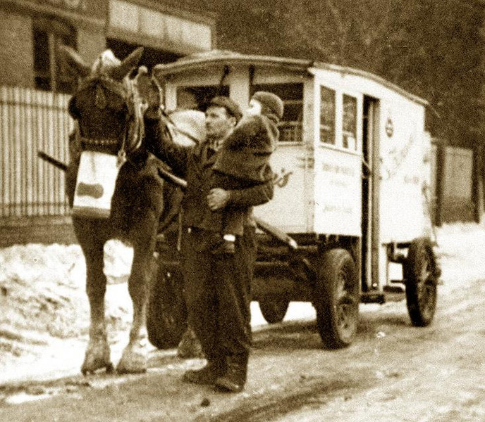 RAY ELLERO (1912-2004),  with his Borden's Milk delivery Wagon and horse, holding his nephew Guy Joseph Lombardi (Oldest child of his sister, Adelia). ca. 1942.