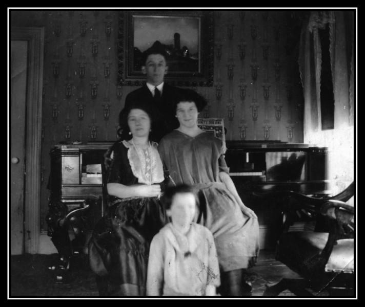 "Back: Joseph Harold Brodeur.<br /> Middle: Unknown & Evelyn ""Pearl"" Brodeur.<br /> Front: Unknown<br /> 1923"