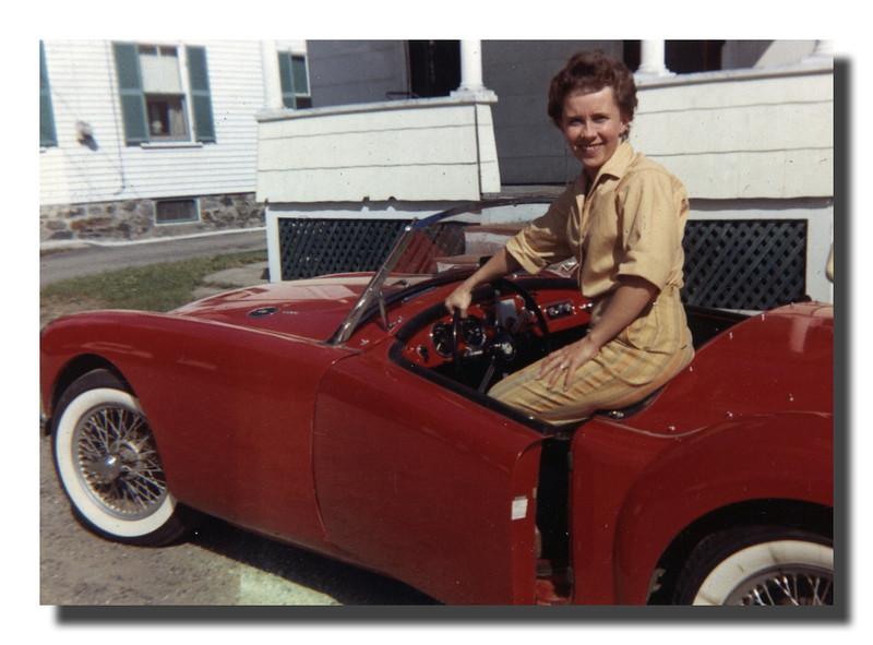 Arlene (Gagan) Hall & cousin Bob's MG at 14 Riverby St., Lowell, MA - 1961.
