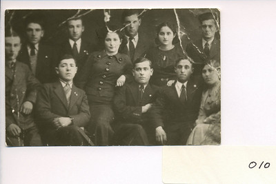 "Mendel and Frieda Feldman with a Havurah group in Sokolow Podlaski in 1938.  Standing in the back row from the left of the picture are:  David Shiedler, Mendel Feldman, leaning to the right of Mendel is Shaindel Pfefferkranz (later married name Kneipper), then Yoseph Penzak, then Frieda Altman (later Feldman), and on the far right Pesach Rubinstein.  In the front from the left of the picture is Avrom Dobzynski (half standing), then to his right and sitting with crossed arms is Beryla Kosova, again half standing is Shaindel Pfefferkranz, then sitting with crossed arms is Zaylik Seschnik and to his right Aaron Toomer and to his right at the far right of the picture in the front is Ytka Vloss.  Only Mendel, Frieda, Shaindel, and Pesach survived the war.  Pesach after he immigrated to the U.S. lived in St. Louis.  Mendel knew his fathr and mother in Sokolow; he also had brothers in Sokolow.  He has a surviving son who lives in Florida.  Mendel attended his son's wedding in Montreal to a Montreal girl.  Pesach's son is an optomotrist.  Pesach's father in Sokolow was a ""remachsh - he made collars for horses.  Pesach had a brother who married a girl from Sokolow that Mendel used to go to school with.  Pesach's mother in Sokolow was called ""die royete bekelach"" (the girl with the pink cheeks).  The mother didn't survive the war.  Mendel points to the picture of Beryla Kosover, who was his best friend.  Beryla had a brother in Chicago by the name of Simcha who Chiam Kawer (an old friend) also knew.  Another face is Aaron Tommer; he was a shoemaker who's father had a barber shop.  Another face pointed to -  Itshik dobzhinksy - he came from a religious family.  Another face - David Schiedler; another face - Zeylig Leschz - he was a shoemaker, older than Mendel.  And another face - Yitka Bloss who moved to Sokolow from the country because Jews were forced to move out.  He father was a ""bala gula"" (wagon driver).  Of the survivors, Shaindel married in Russia during the war, was sent away to Siberia, and later wound up in Israel (in Lod).  Mendel and Frieda visited with he in 1968 when they took a trip to Israel. Mendel got this picture from Shaindel when he found her in Israel on their trip in 1968,  There is an inscription on the back of the picture in yiddish: ""Ich shick dir dos bild fun unsere kinder yuren.  Ich wunsch ihr a gesuhnte yuhr mit fuhl naches.  Shaindel."" (Translation:  I'm sending you this picture from our childhood years.  I wish you a healthy year with much good luck.)"