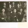 """Mendel and Frieda Feldman with a Havurah group in Sokolow Podlaski in 1938.  Standing in the back row from the left of the picture are:  David Shiedler, Mendel Feldman, leaning to the right of Mendel is Shaindel Pfefferkranz (later married name Kneipper), then Yoseph Penzak, then Frieda Altman (later Feldman), and on the far right Pesach Rubinstein.  In the front from the left of the picture is Avrom Dobzynski (half standing), then to his right and sitting with crossed arms is Beryla Kosova, again half standing is Shaindel Pfefferkranz, then sitting with crossed arms is Zaylik Seschnik and to his right Aaron Toomer and to his right at the far right of the picture in the front is Ytka Vloss.  Only Mendel, Frieda, Shaindel, and Pesach survived the war.  Pesach after he immigrated to the U.S. lived in St. Louis.  Mendel knew his fathr and mother in Sokolow; he also had brothers in Sokolow.  He has a surviving son who lives in Florida.  Mendel attended his son's wedding in Montreal to a Montreal girl.  Pesach's son is an optomotrist.  Pesach's father in Sokolow was a """"remachsh - he made collars for horses.  Pesach had a brother who married a girl from Sokolow that Mendel used to go to school with.  Pesach's mother in Sokolow was called """"die royete bekelach"""" (the girl with the pink cheeks).  The mother didn't survive the war.  Mendel points to the picture of Beryla Kosover, who was his best friend.  Beryla had a brother in Chicago by the name of Simcha who Chiam Kawer (an old friend) also knew.  Another face is Aaron Tommer; he was a shoemaker who's father had a barber shop.  Another face pointed to -  Itshik dobzhinksy - he came from a religious family.  Another face - David Schiedler; another face - Zeylig Leschz - he was a shoemaker, older than Mendel.  And another face - Yitka Bloss who moved to Sokolow from the country because Jews were forced to move out.  He father was a """"bala gula"""" (wagon driver).  Of the survivors, Shaindel married in Russia during the war, was """