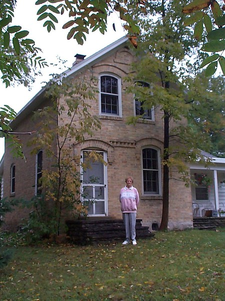 "Amelia (Clark) in front of ""Grandma's House"" on Juddville Road"