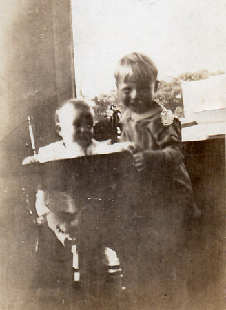Bill Jr. (2 1/2) and Dot (1 year old), Wilmette, Ill. on Central Ave., on porch
