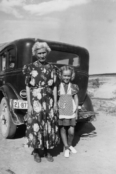 Winnie Galey Marshall with Darlene Allison.  Undated, and we don't know for sure where the photo was taken.  The 21 country car behind them is from Scotts Bluff County in Nebraska.  Our thanks to Stanley Johnson of St. Joseph, Missouri, for providing this photograph and identifying the subjects.<br /> <br /> Winnie was the eighth child of Simon and Elizabeth (Sprinkle) Galey.   She was born in 1866 in Indiana and married Ben Marshall in Falls City, Nebraska, in 1881.  She died 2 November 1945 in Barnard, Missouri.