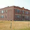 Built in 1927, the old school remains the most formidable structure in the remains of Buffalo, Montana, which is no longer included on many maps.  Folks at the nearby Judith Gap school -- which appears to be thriving -- weren't sure where records went when the school closed.  Perhaps Hobson or Moore.  We found a few Buffalo school attendance records from the 1920's in the courthouse at Stanford, but no Galeys were listed.