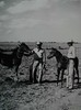 """Taken on King Ranch, circa late 1930's.  """"Breaking Colts.""""<br /> <br /> On Right:  Lauro F. Cavazos<br /> On Left:  Unknown man, could be Mr. Kleberg."""