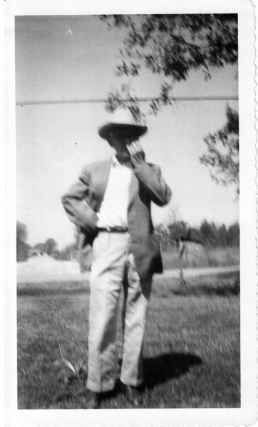 Dink Barnett McGee circa 1930 or so, maybe a little before or after, not sure.  Not a very good picture, the original is blurred and his hand is obscuring his face.  I scanned this image at 600 dpi, the highest resolution setting on the scanner.  As such, it is an excellent reflection of what the original looks like.  Courtesy of Linda Lou McGee Weldon, grand daughter of Dink McGee.